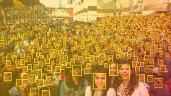 Selfie with a crowd of people framed by artificial intelligence